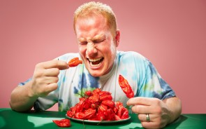 The most Bhut Jolokia chilli peppers eaten in two minutes is 66 grams (2.33 oz) and was achieved by Jason McNabb (USA) on the set of «Guinness World Records Unleashed» in Los Angeles, California, USA, on 19 June 2013.  Three people attempted this record head-to-head, with the other two achieving 45 and 46 grams, respectively (Photo Credit: shockrecord).